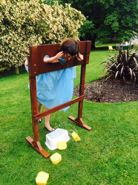The inclement weather didn't dampen our spirits at the Summer Fair - but poor Miss Cordingley got a good soaking!